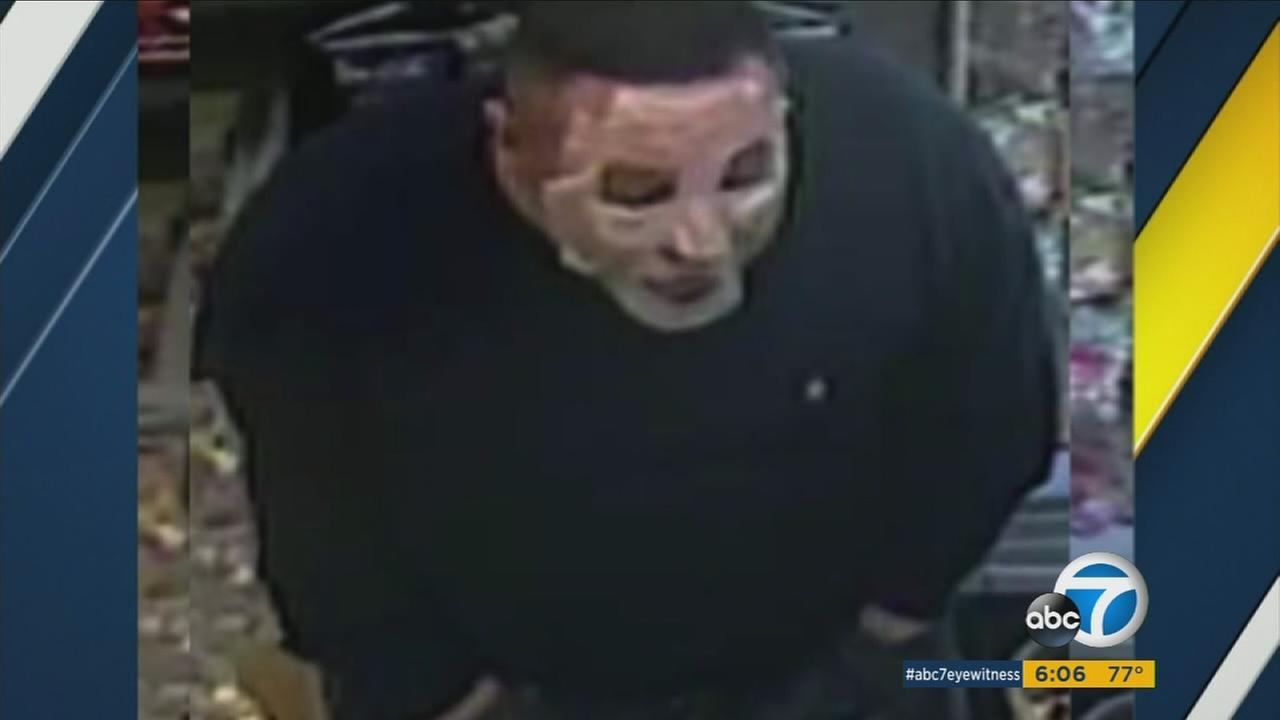 An armed man wearing a womens facial beauty mask is terrorizing Eagle Rock with seven robberies in two weeks.