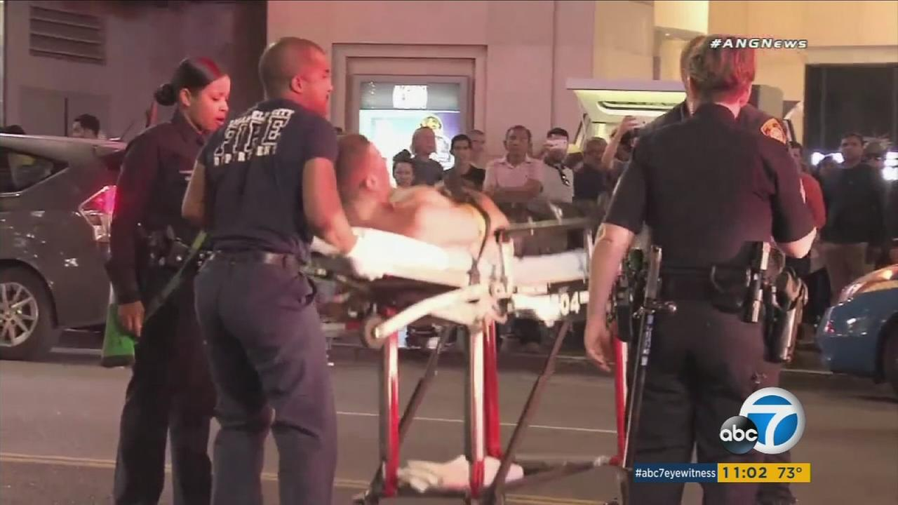 A stabbing victim is shown being taken to an ambulance in a gurney on Hollywood Boulevard on Wednesday, Nov. 22, 2017.