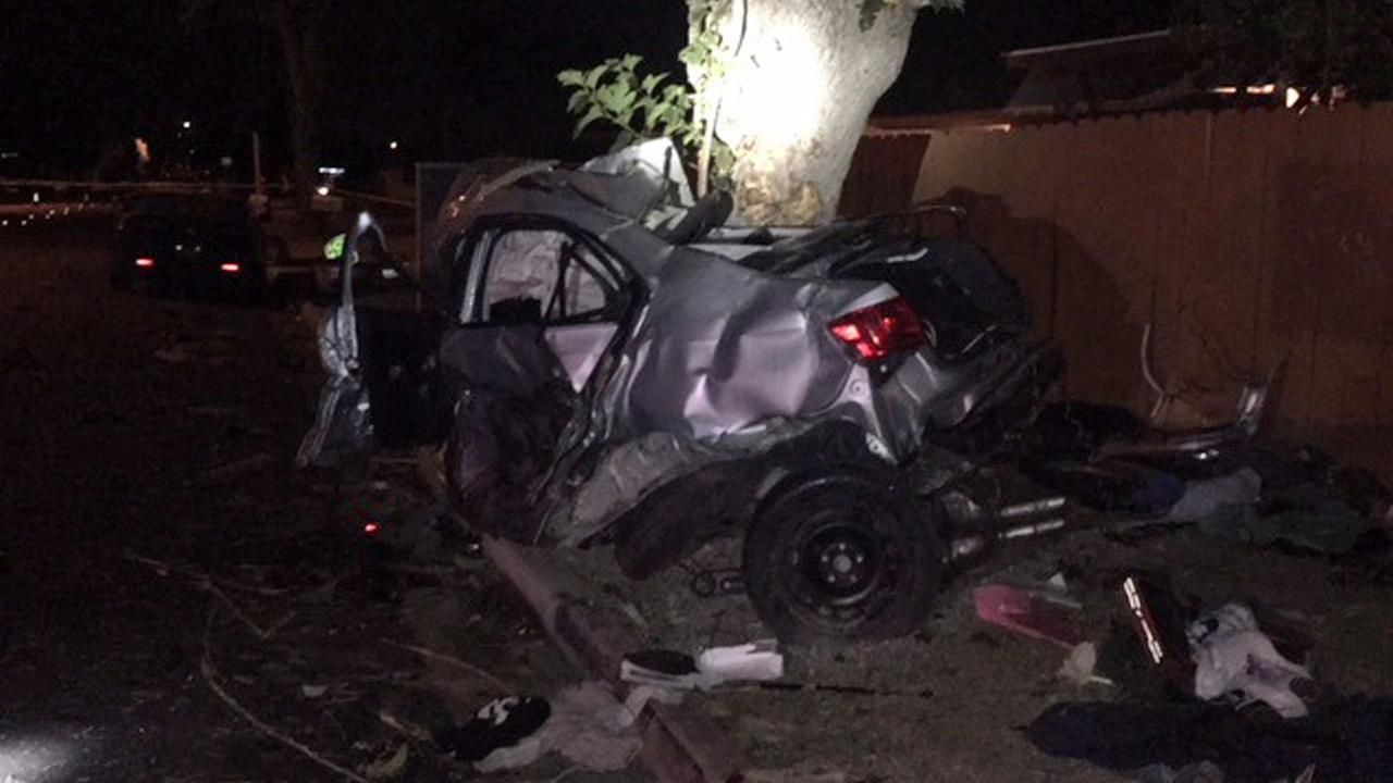 A silver Volkswagen is shown partially wrapped around a tree after a high-speed crash at an intersection sent it flying on Thursday, Nov. 23, 2017.
