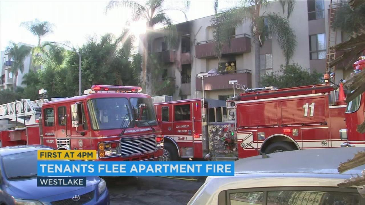 Two firefighters suffered burns to their ears Saturday morning after responding to a fire at an apartment building in Westlake, officials said.