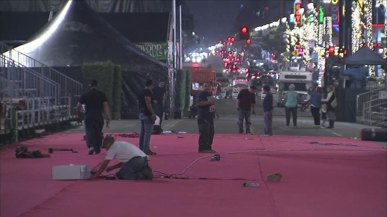 Crews are preparing the red carpet for Sundays Hollywood Christmas Parade.