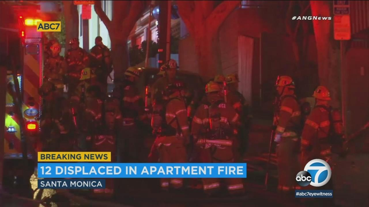 Twelve residents were displaced after a fire erupted early Thursday morning at a three-story apartment building in Santa Monica, officials said.