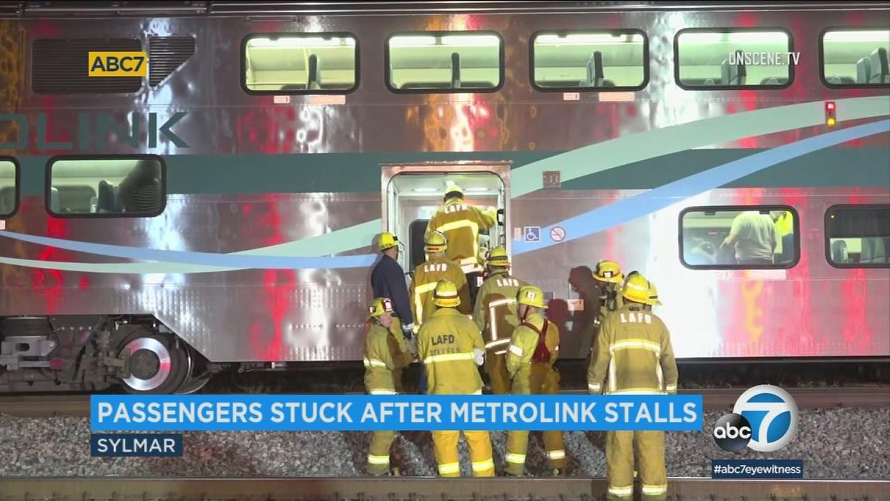 Emergency personnel are seen in Sylmar, where a Metrolink train experienced technical issues and became stranded.