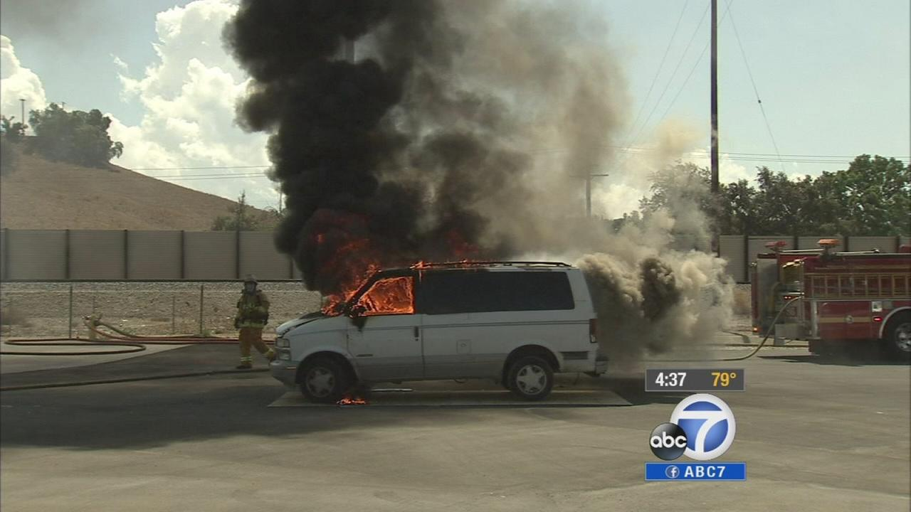 A minivan is set on fire in this undated file photo.