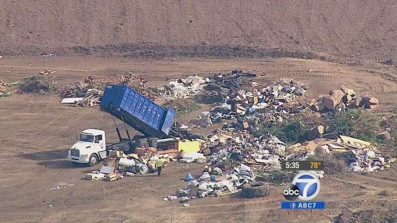 A truck dumps trash at Scholl Canyon Landfill in Glendale.