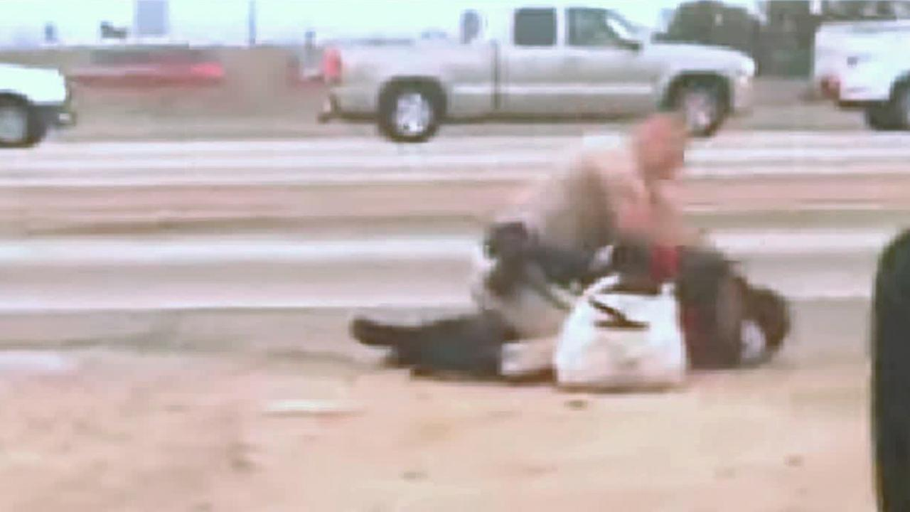 CHP officer Daniel Andrew hits Marlene Pinnock repeatedly on the 10 Freeway in Los Angeles in this screen grab of a cell phone video.