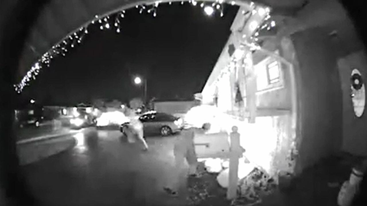 Two vandalism suspects are shown in front of a Whittier home as they puncture three Christmas blow-up decorations.