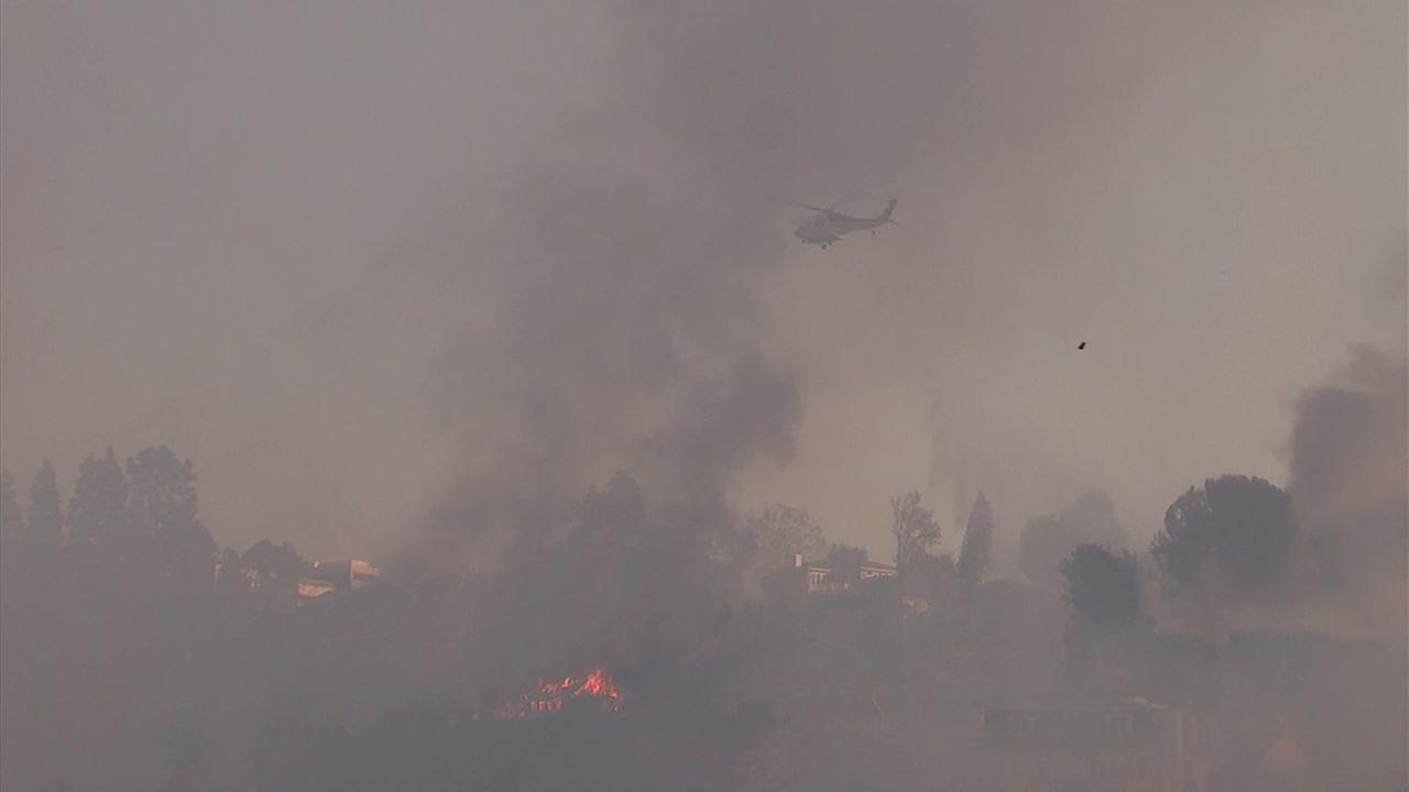 Smoke and flames are seen from the Skirball Fire on Wednesday, Dec. 6, 2017.