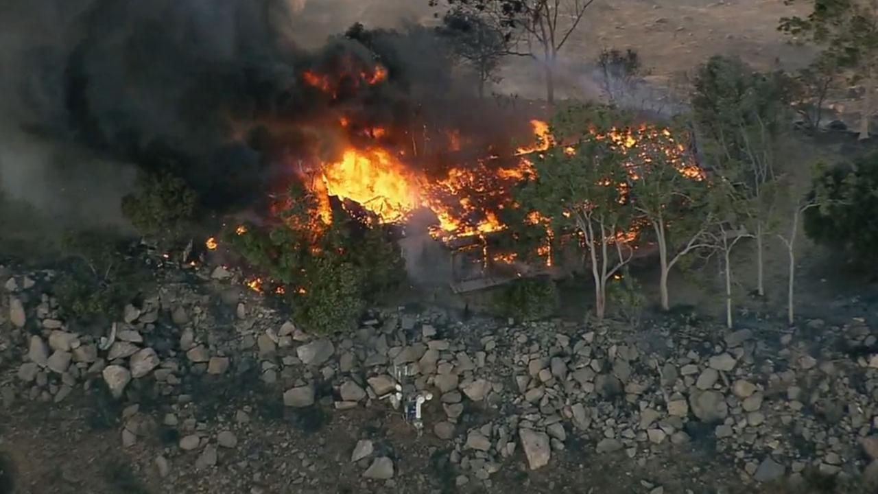 'At least one home could be seen burning from the air. The blaze was 0 percent contained around 3:30 p.m., officials said.' from the web at 'http://cdn.abclocal.go.com/content/kabc/images/cms/automation/vod/2753786_1280x720.jpg'