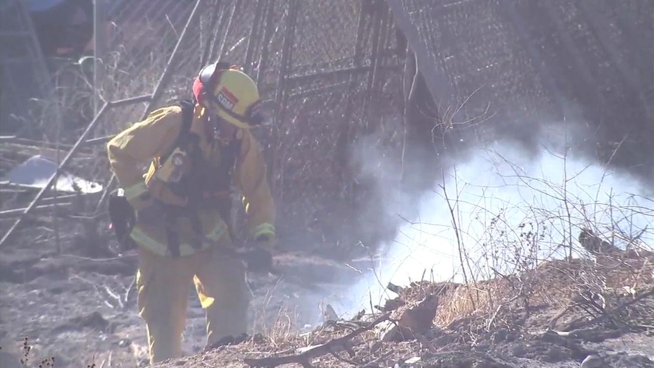 'A firefighter worked on a hot spot after the Creek Fire ripped through an area in Sylmar.' from the web at 'http://cdn.abclocal.go.com/content/kabc/images/cms/automation/vod/2753917_1280x720.jpg'