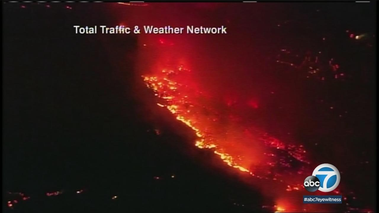 'A fire scorches a portion of northern San Diego County on Thursday, Dec. 7, 2017.' from the web at 'http://cdn.abclocal.go.com/content/kabc/images/cms/automation/vod/2754317_1280x720.jpg'