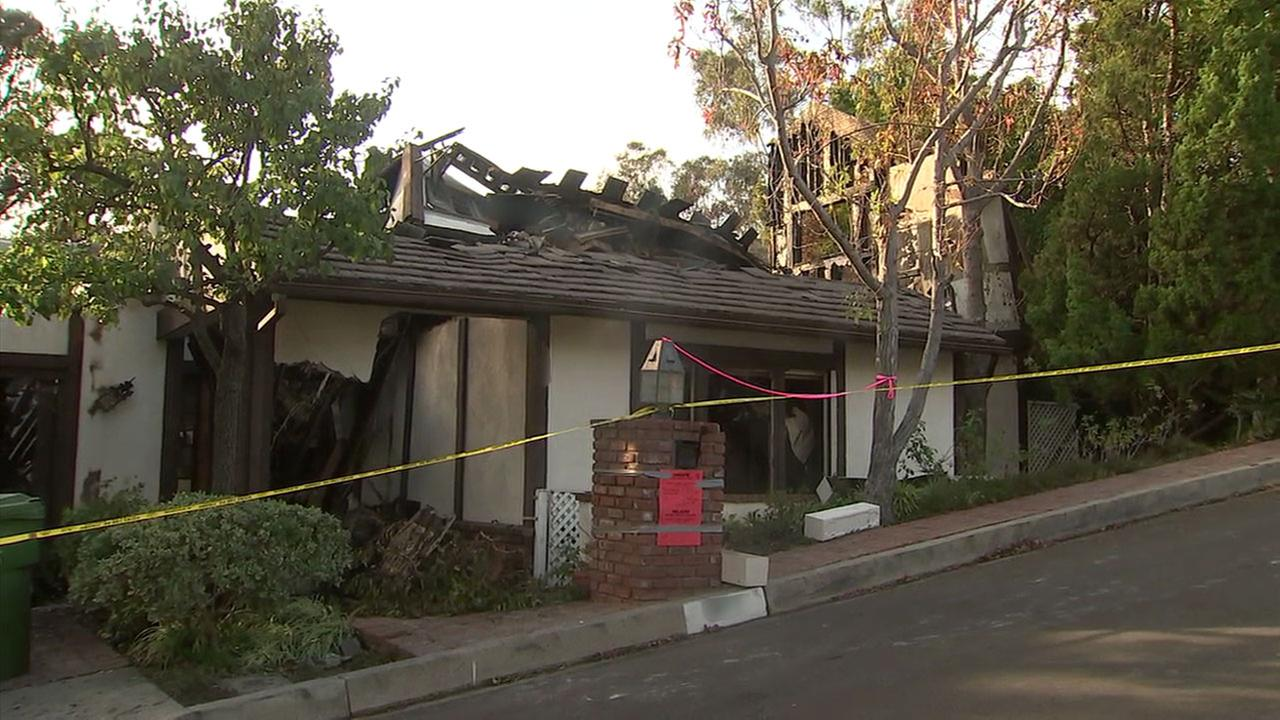 A damaged home is shown in the Bel Air area of Los Angeles as the Skirball Fire swept through.