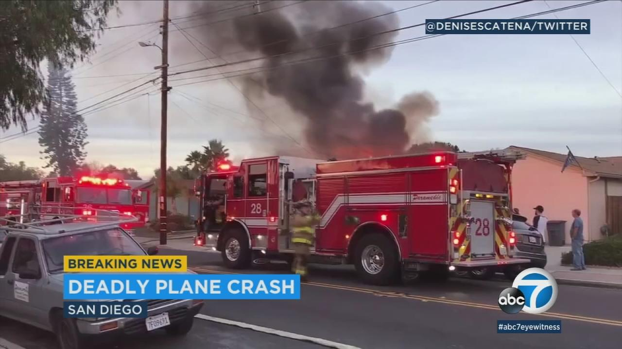 Plumes of smoke are seen from a deadly San Diego plane crash on Saturday, Dec. 9, 2017.