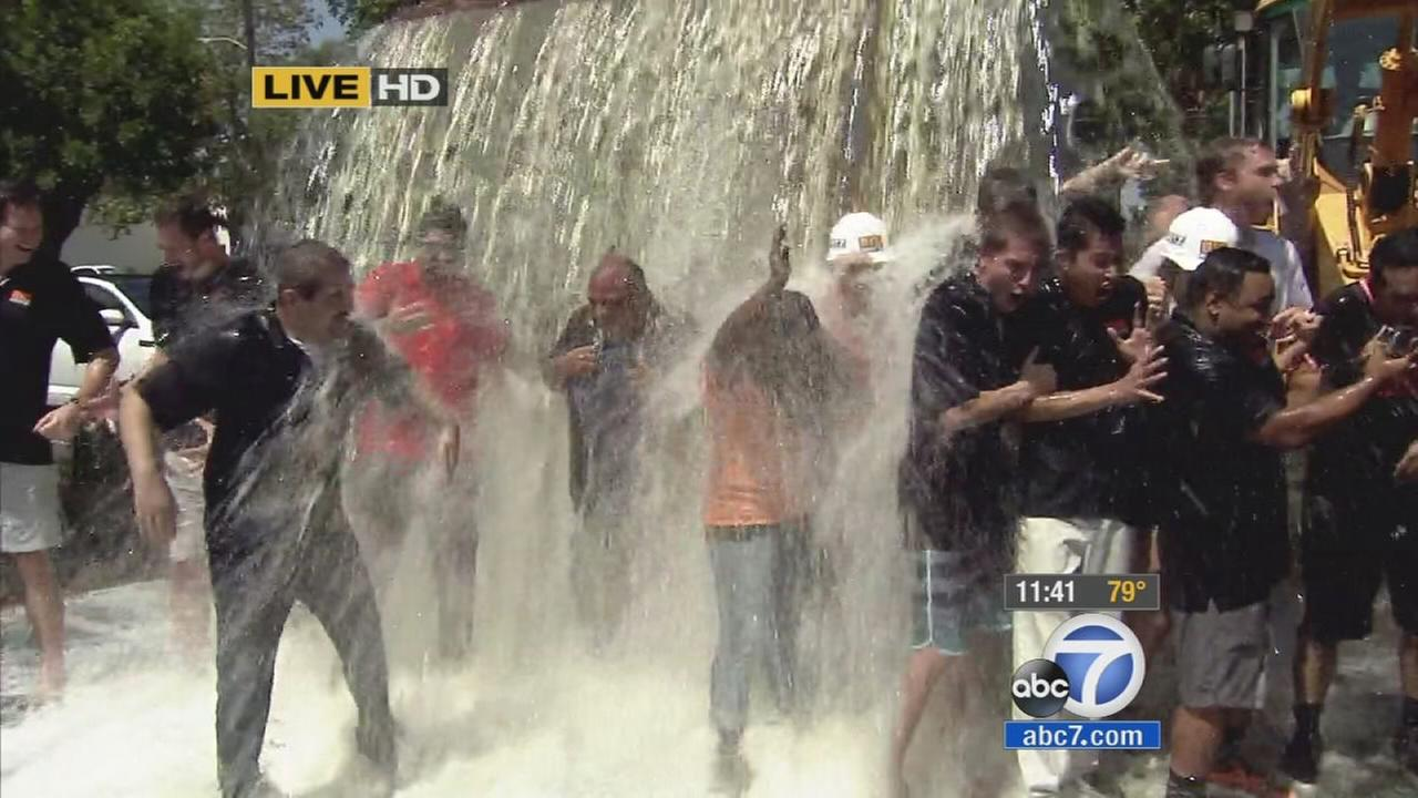 Dozens of employees of Irvine company Big Rentz accepted the ALS Ice Bucket Challenge live on ABC7 on Friday.