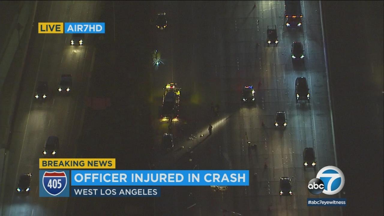 A Los Angeles Police Department officer suffered a serious leg injury in a multi-vehicle crash that resulted in a partial closure of the 405 Freeway in West Los Angeles.