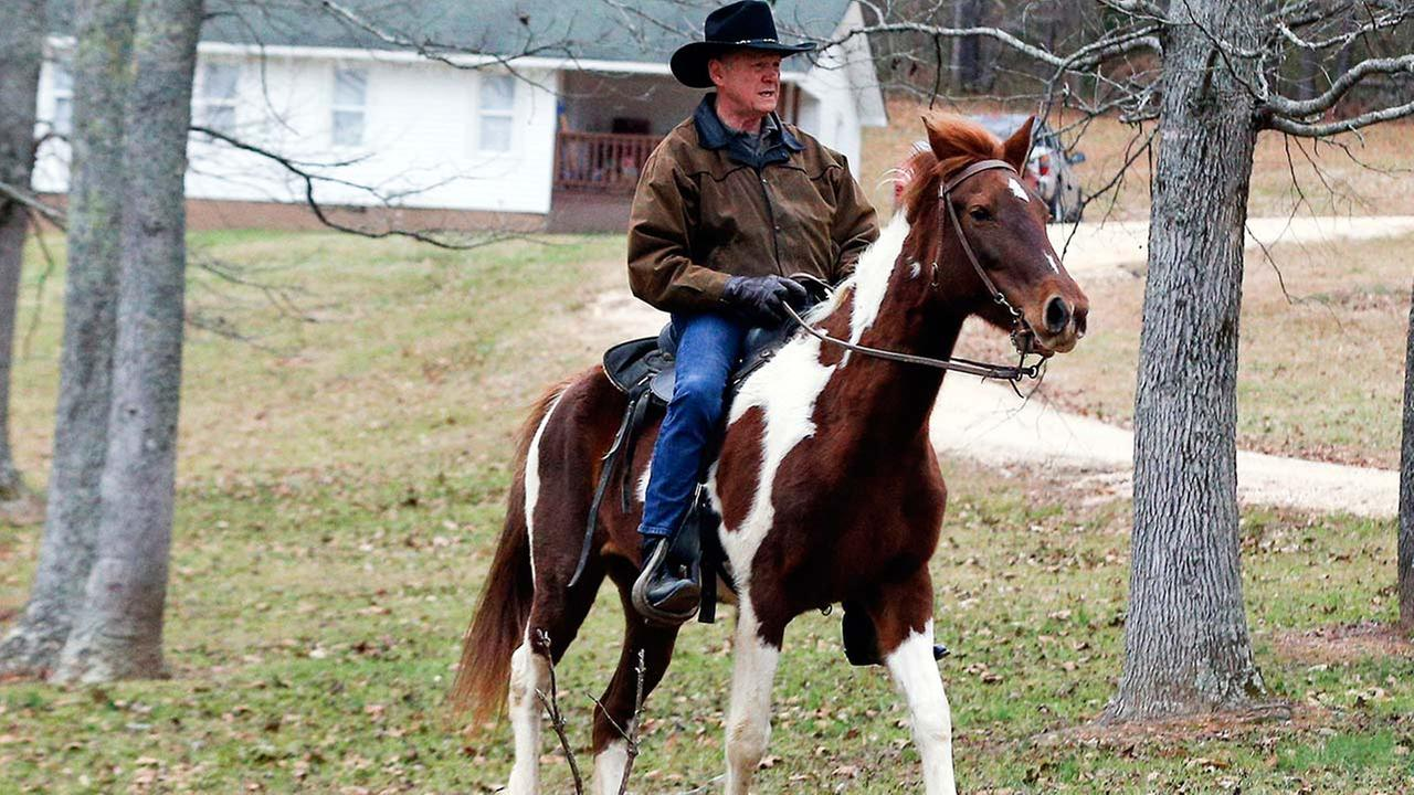 U.S. Senate candidate Roy Moore rides a horse to vote during the Alabama senatorial election, Tuesday, Dec. 12, 2017, in Gallant, Alabama.