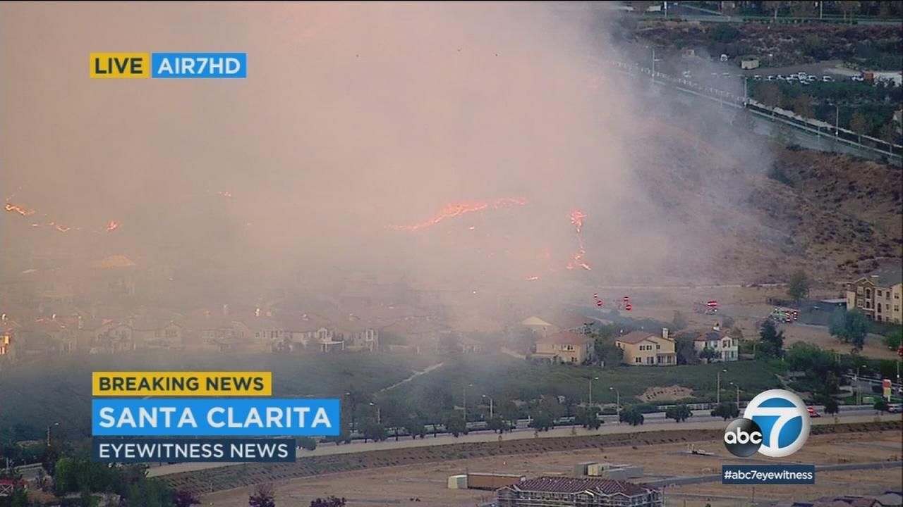 A brush fire burned about two acres in the hills of Santa Clarita before firefighters were able to get it under control.
