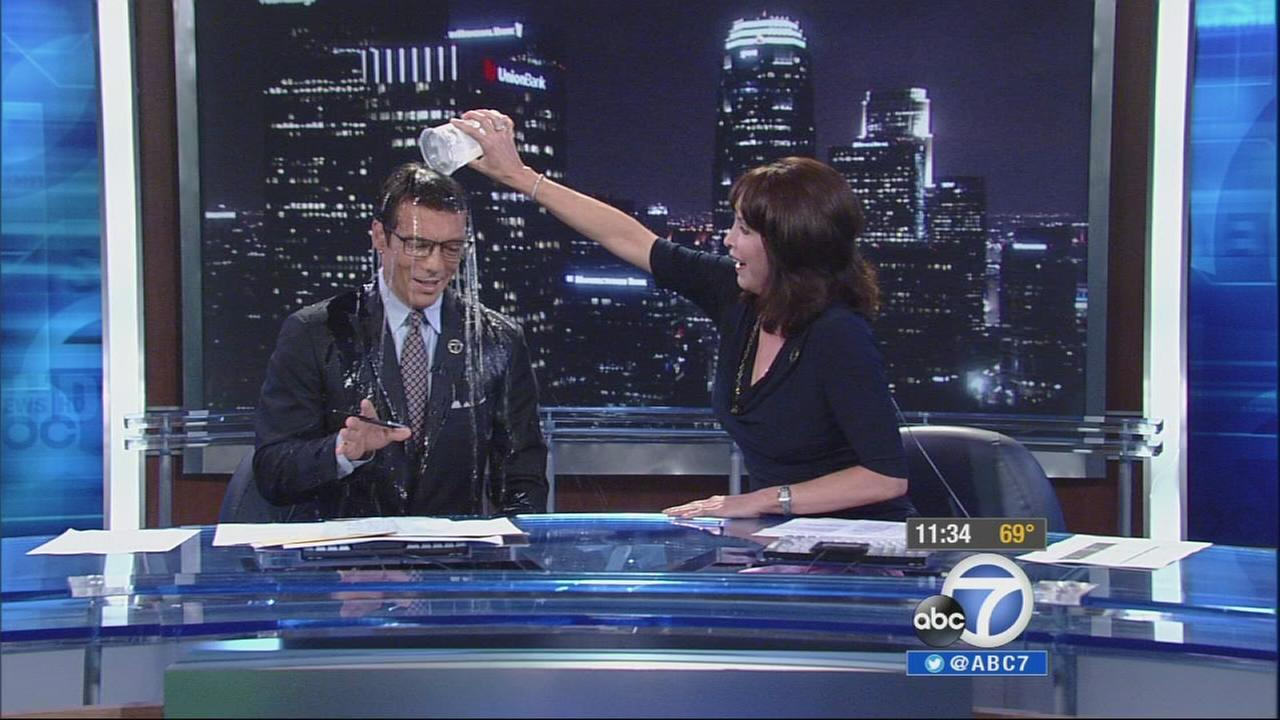 Ellen Leyva ours ice water on David Ono as part of the ALS Ice Bucket Challenge on Friday, Aug. 22, 2014.