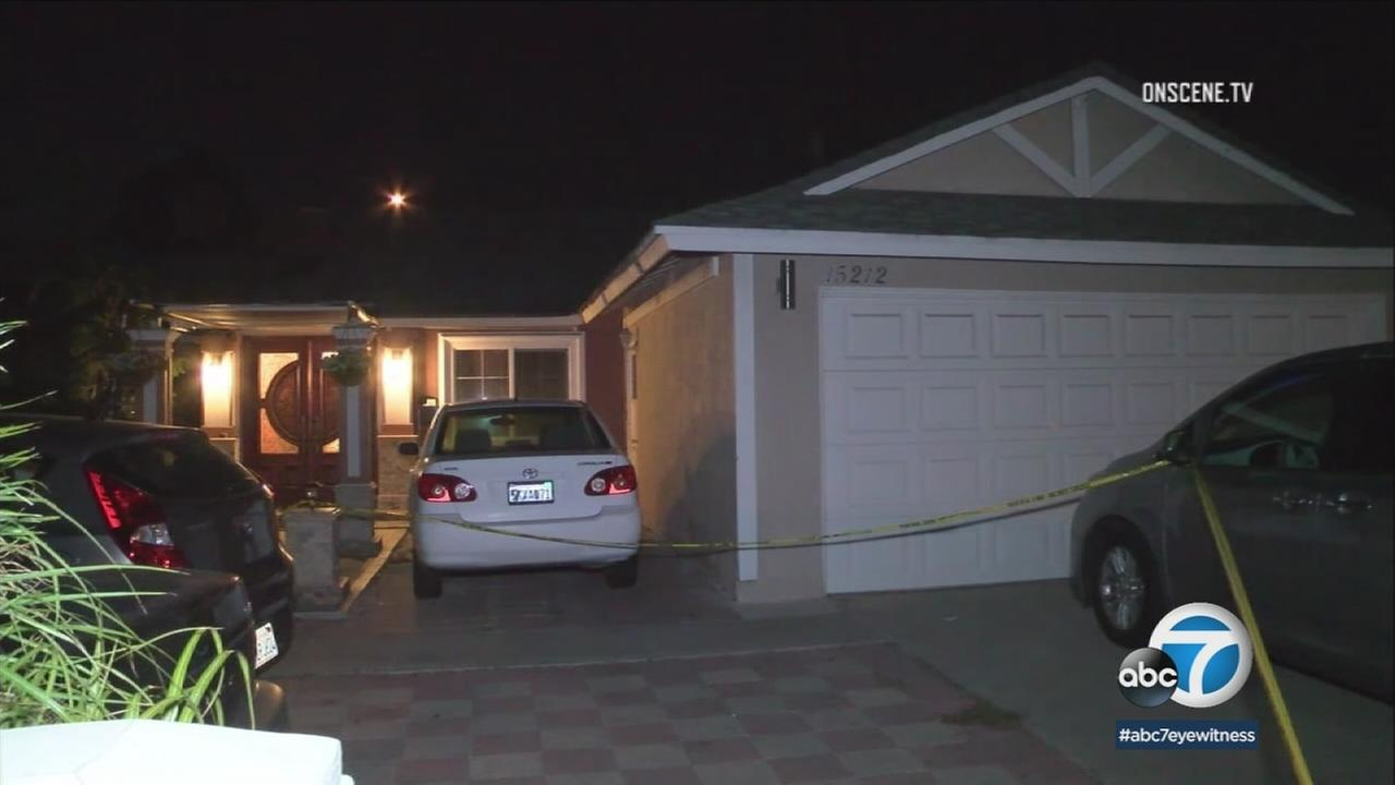 Crime tape surrounds a Westminster home where a woman was arrested in connection with the death of a 4-month-old baby boy on Tuesday, Dec. 12, 2017.