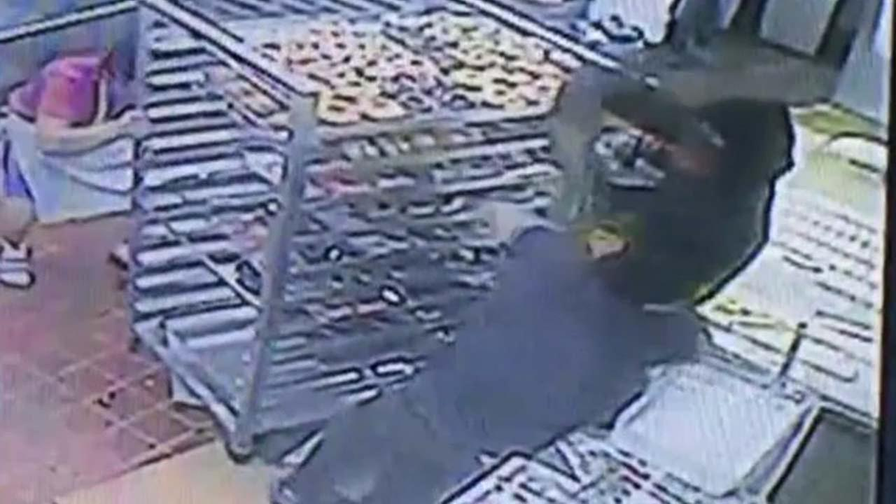 Surveillance footage shows the suspect and victim struggling before the suspect fires his weapon.