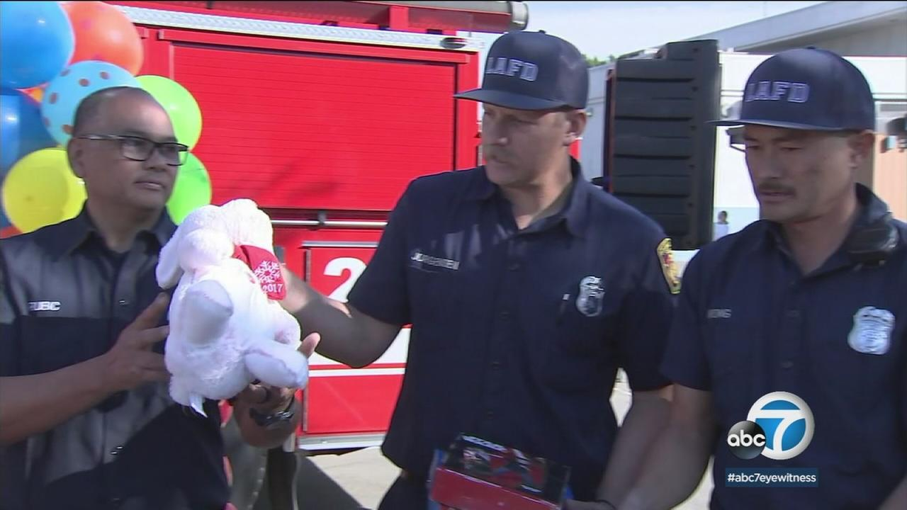 The kids there celebrated a kind of Christmas morning thanks to quite a few firefighters and Santa.