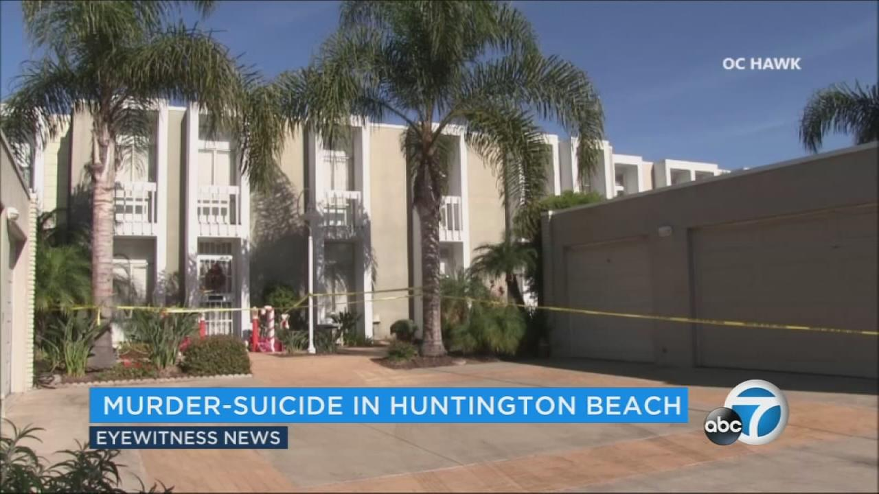 Yellow crime scene tape ropes off a condo complex in Huntington Beach.