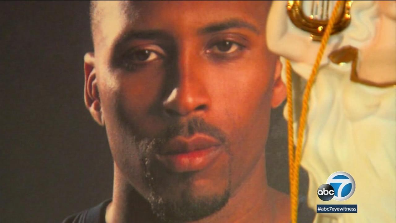 Former NBA player Lorenzen Wright is shown in a photo at a memorial set up at his home.