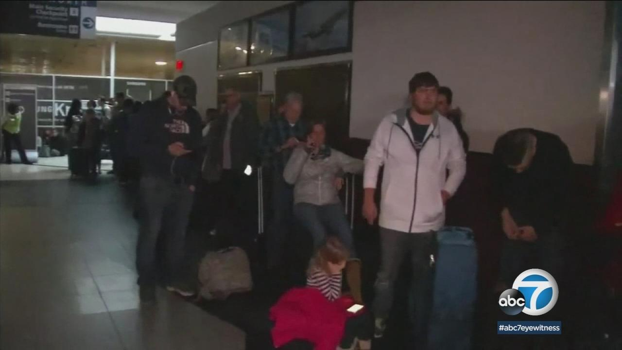 Travelers seen stranded at an Atlanta airport amid a major power outage on Sunday, Dec. 17, 2017.