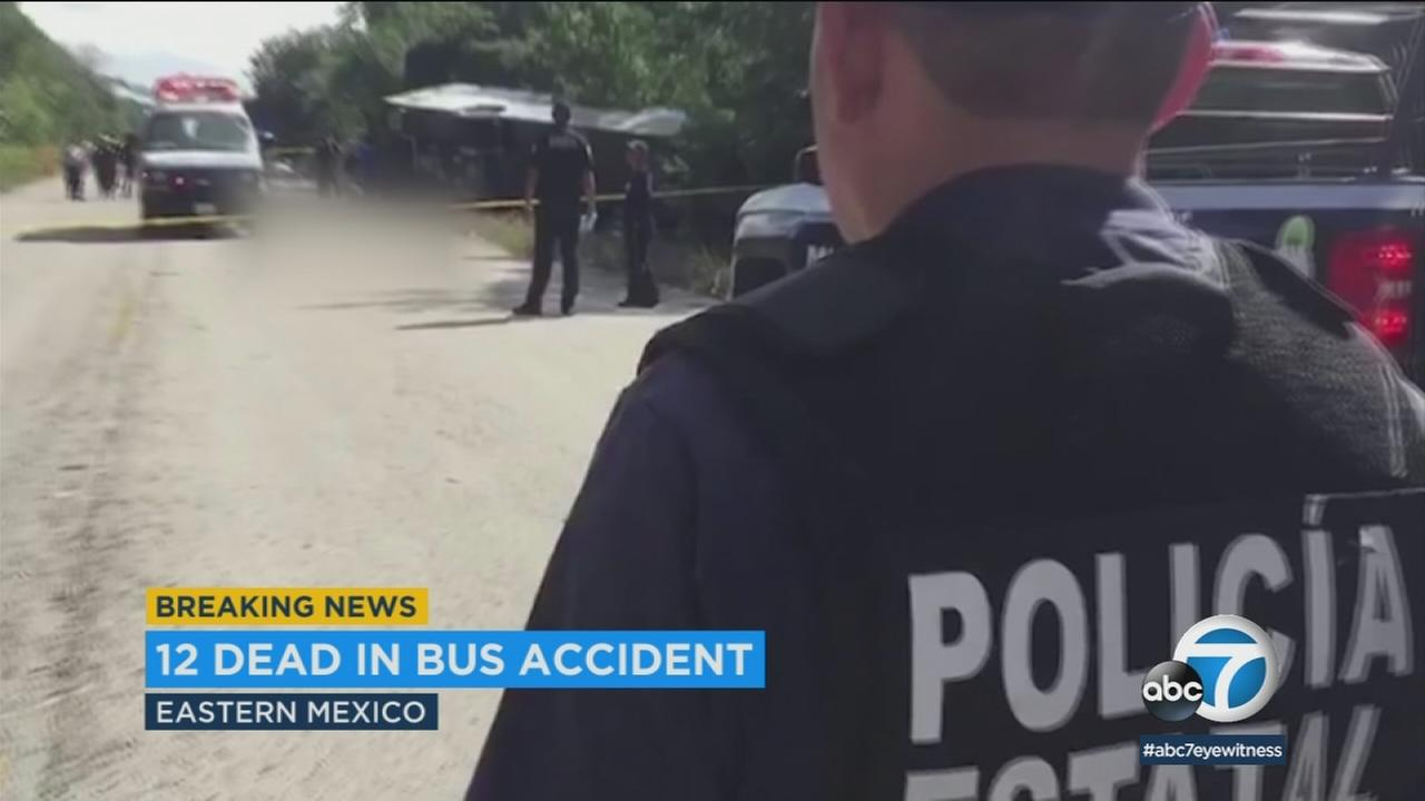 A police officer is seen near the scene of a fatal bus crash in Mexico on Tuesday, Dec. 19, 2017.