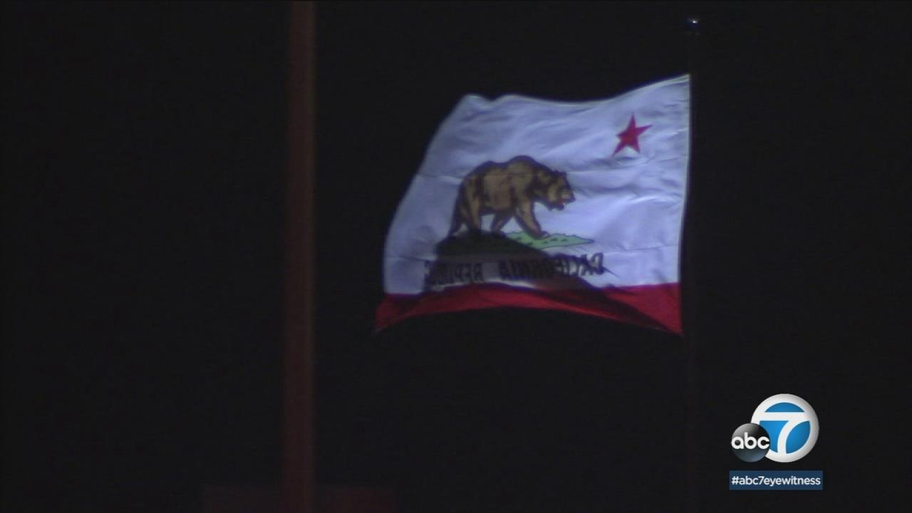 The California flag is shown whipping through strong winds in Southern California on Wednesday, Dec. 20, 2017.
