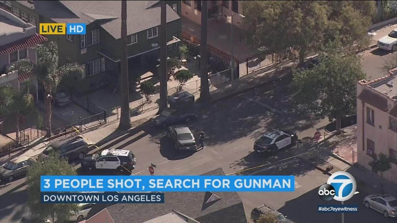 Los Angeles police are searching for a gunman after three people were shot in the 1800 block of S. Bonnie Brae just west of downtown Los Angeles.