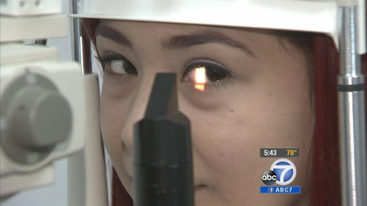 Claudia Herrera gets her eyes check in this undated file photo.