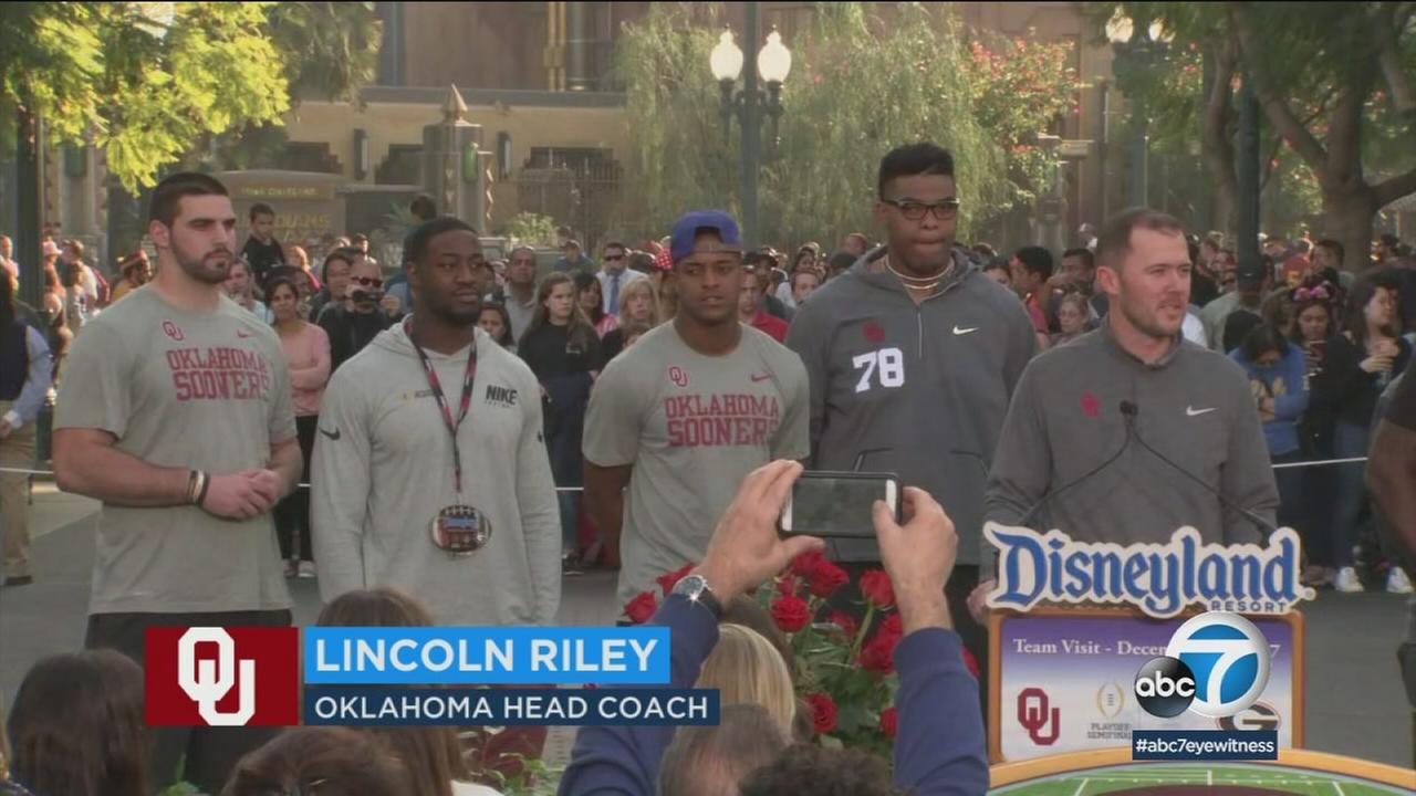 Oklahoma football players are shown while enjoying Disneyland before the annual Rose Bowl game.