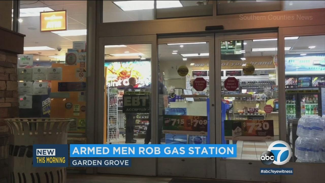 Two men armed with a gun robbed a gas station in Garden Grove and authorities are investigating whether the incident is connected to two similar recent crimes in Orange County.