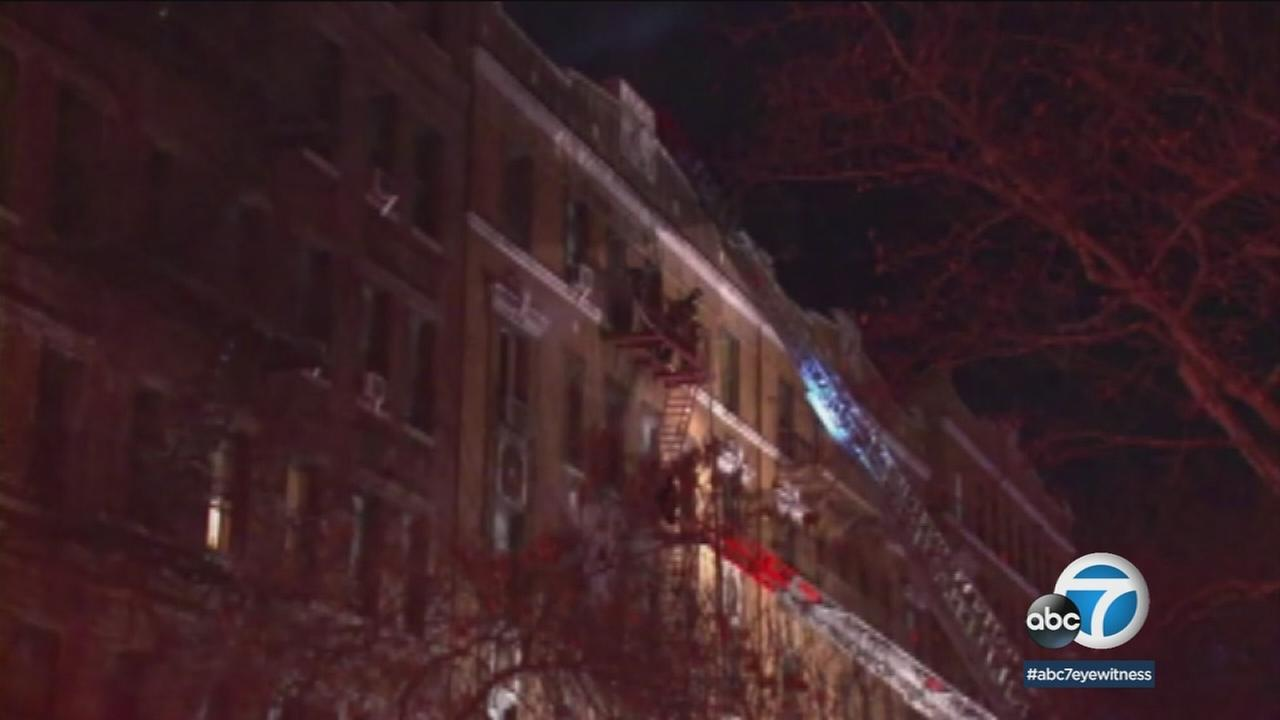 Firefighters at the scene of a deadly apartment fire that left at least 12 dead in the Bronx on Thursday, Dec. 28, 2017.