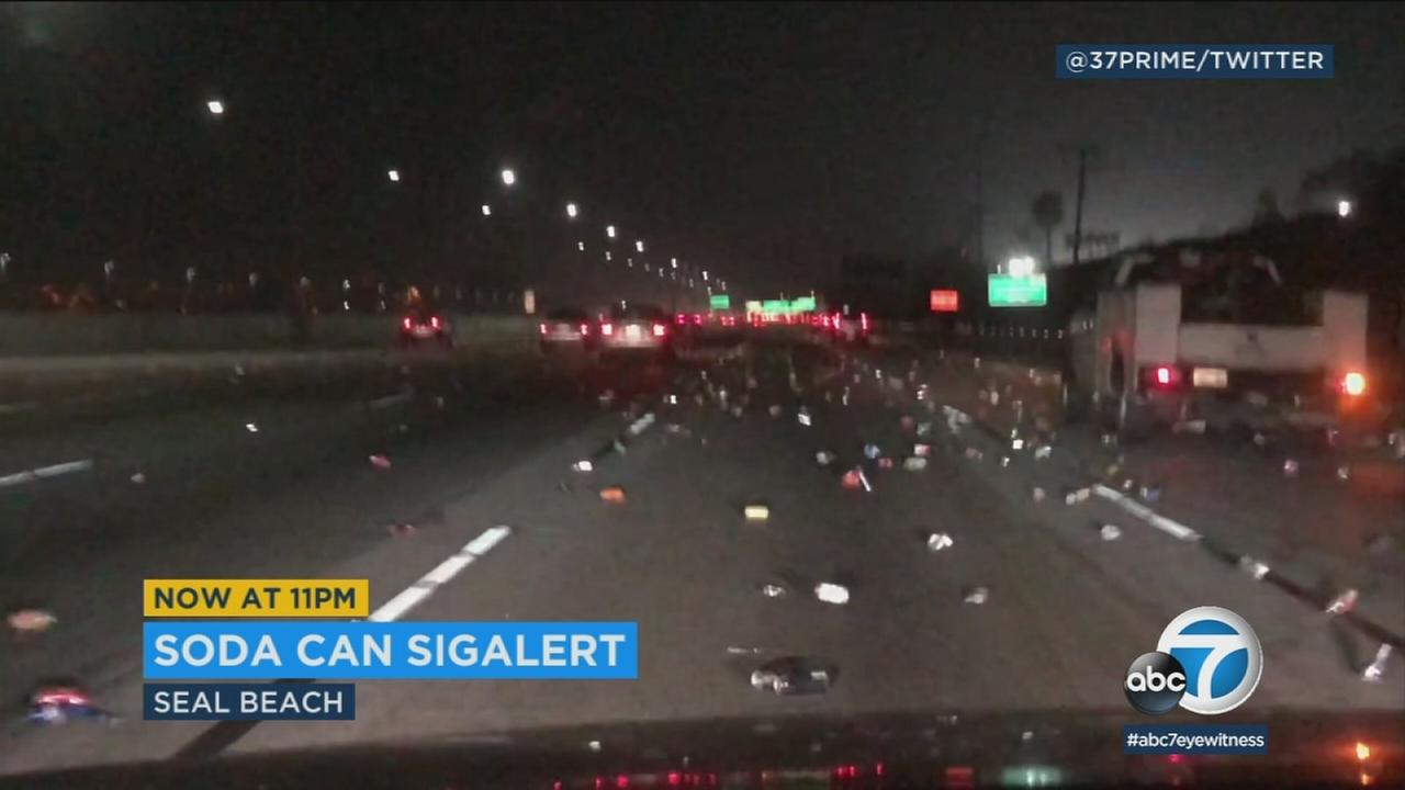 Hundreds of cans seen scattered across the 405 Freeway in Seal Beach on Thursday, Dec. 28, 2017.