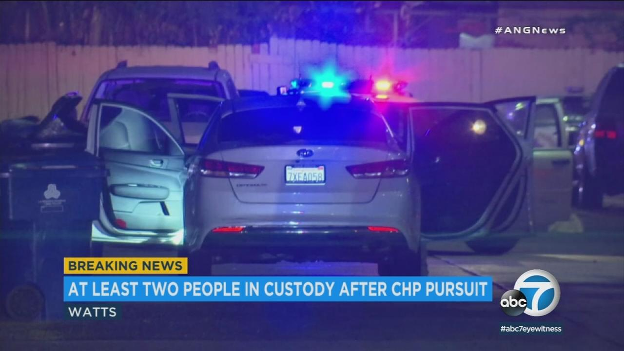 Two men were apprehended and a third was at large after the robbery of a gas station in Chino Hills was followed by a chase that ended some 40 miles away in Watts.