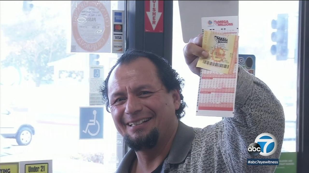 A man at an Orange 7-Eleven shows off his Powerball and Mega Millions tickets in the hopes of winning the big jackpots during drawings over the New Years weekend.