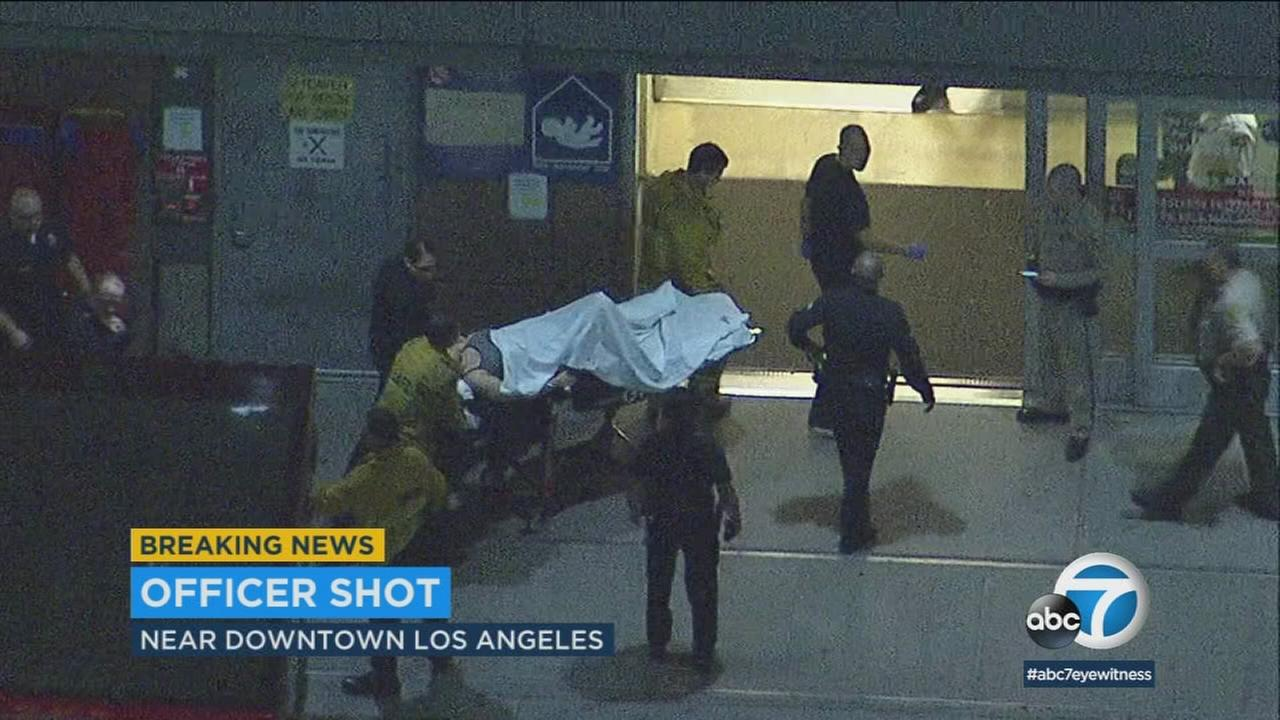 A female officer is seen transported inside a hospital after being shot near downtown Los Angeles late Friday, Dec. 29, 2017.