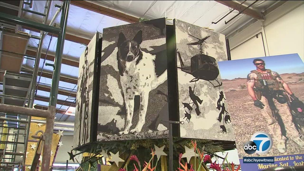 Search-and-rescue dog Rocket is shown on a Rose Parade float while its housed at a warehouse in Irwindale.