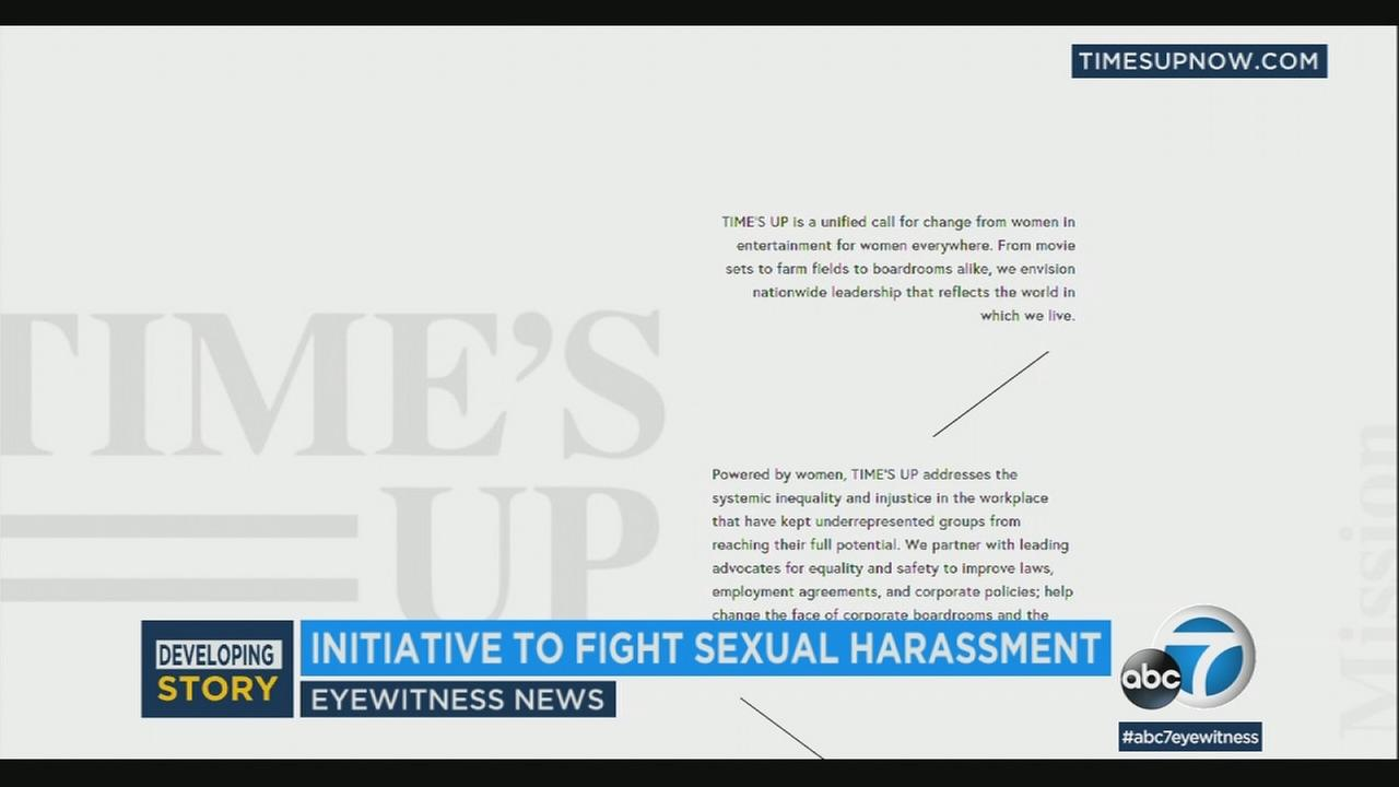 The website for the anti-harassment group Times Up is shown in a photo.