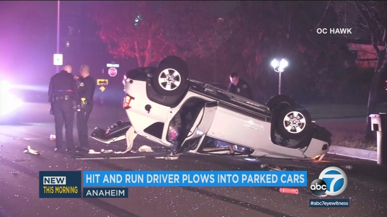 A vehicle driven by a suspected drunk driver is seen overturned after the driver crashes into several parked cars in Anaheim on Monday, Jan. 1, 2018.
