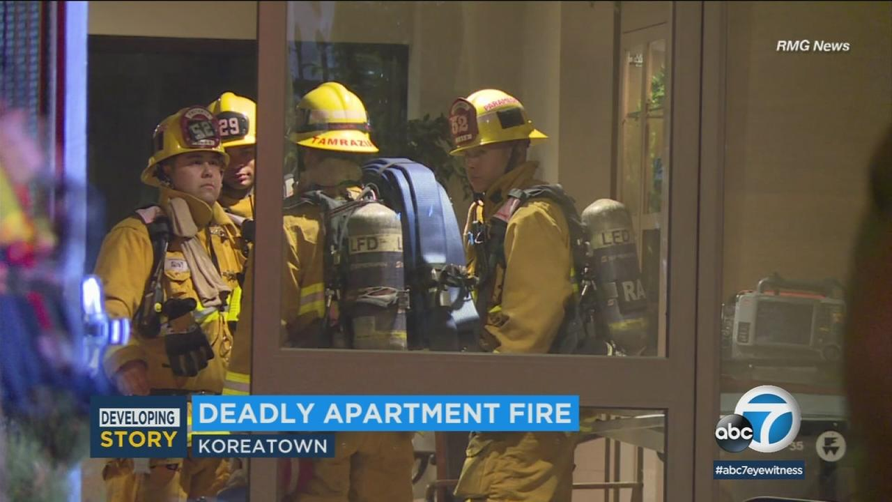 Firefighters are at the scene of a deadly apartment fire in Koreatown on Monday, Jan. 1, 2018.