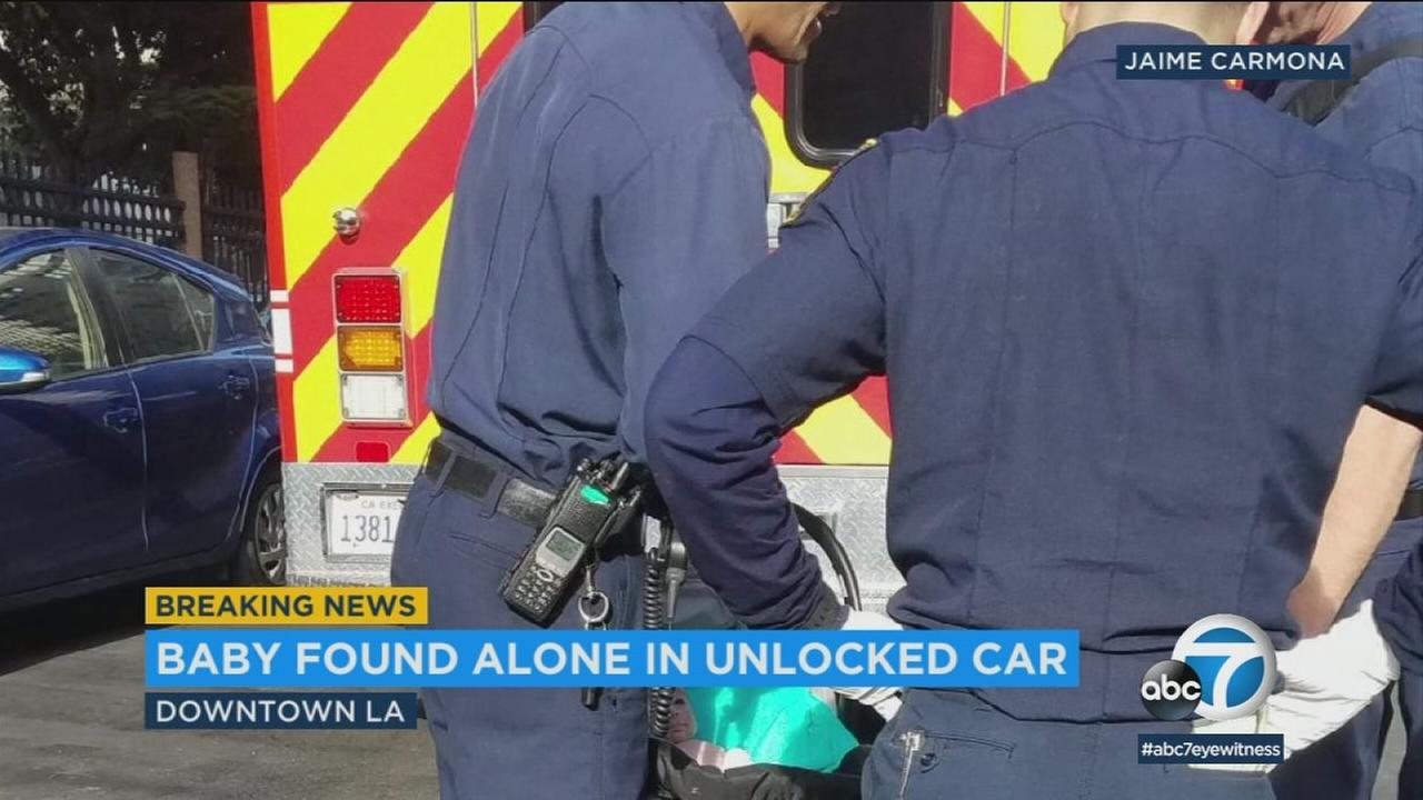 Police are questioning a woman after an infant was found alone in an unlocked car in downtown Los Angeles Thursday.