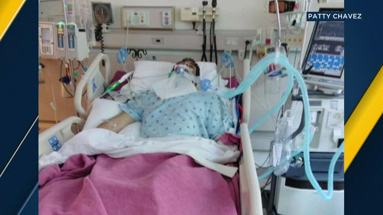 Raul Sepulveda, 21, is shown in a hospital bed after his family said he was beaten by El Monte police officers last year.
