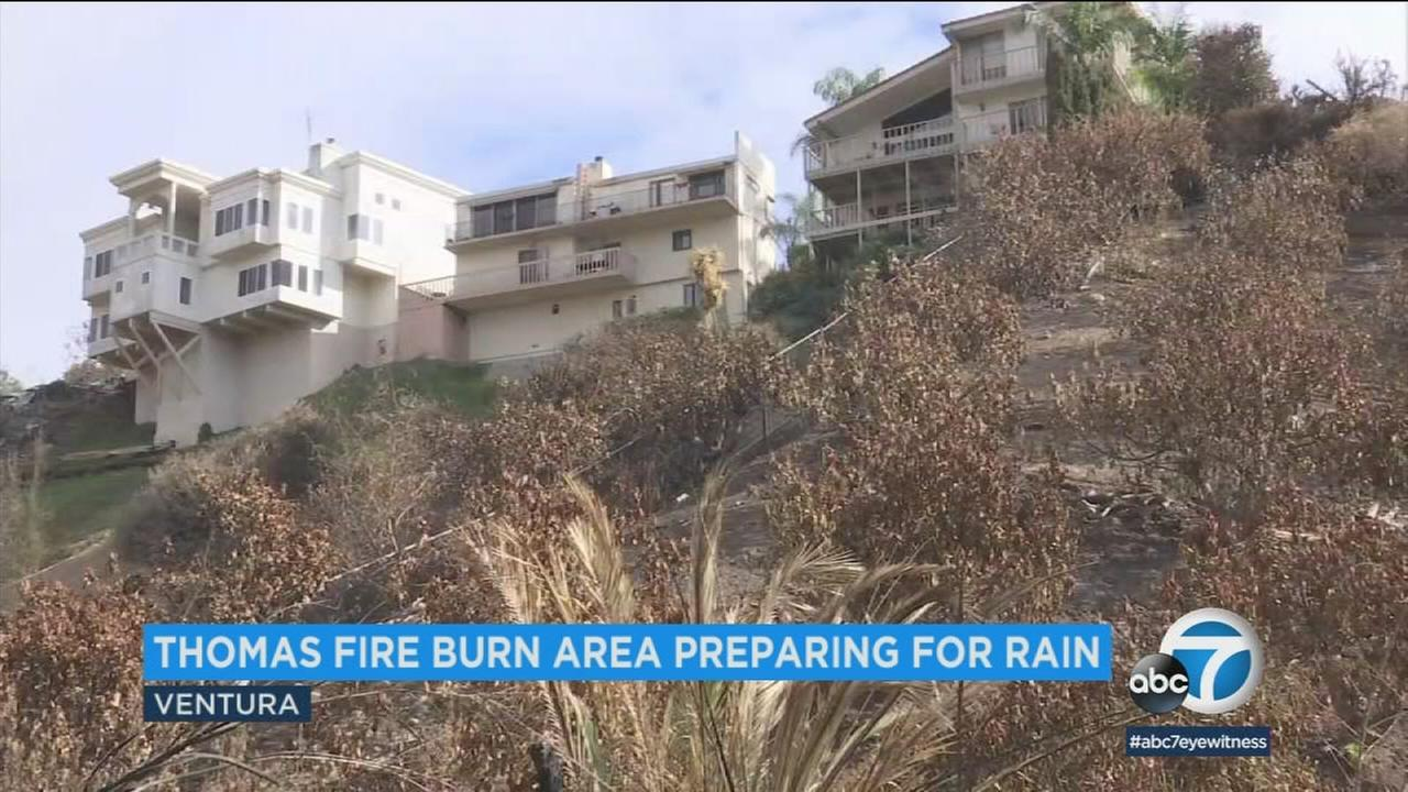 Homes along a hillside that was charred by the Thomas Fire are shown in a photo as the area prepares for possible rain that could cause mudslides.