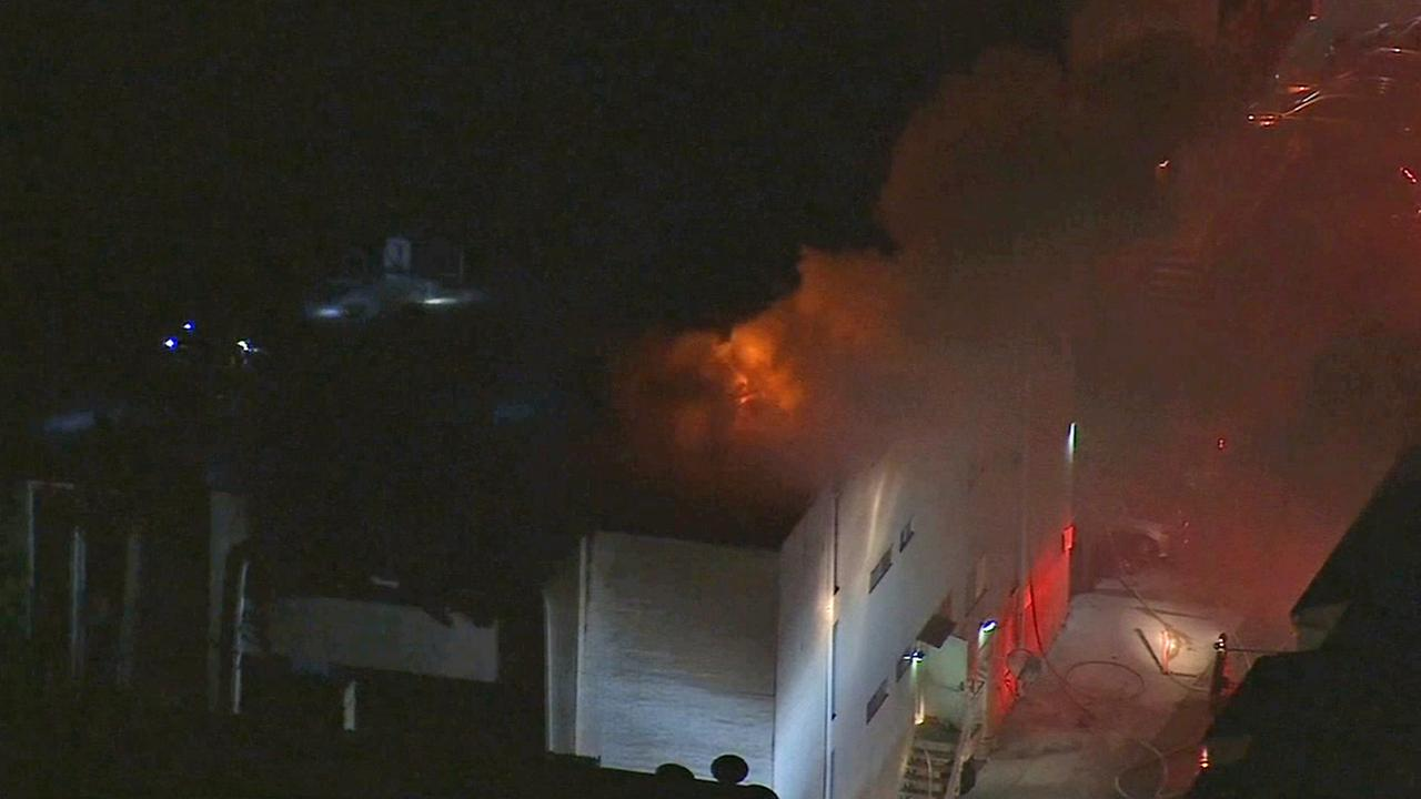 Firefighters battle a blaze at an apartment building in Encino on Thursday, Aug. 28, 2014.