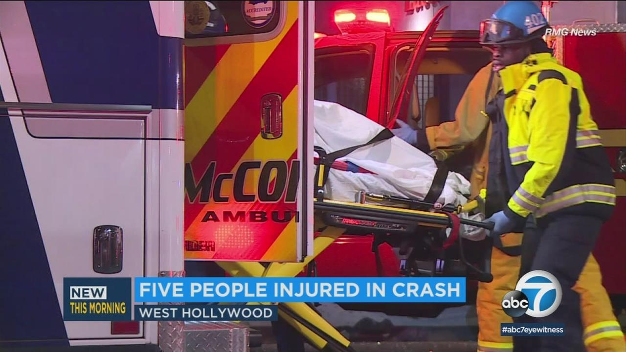 A crash victim is placed into an ambulance following a three-car collision in West Hollywood on Saturday, Jan. 6, 2018.