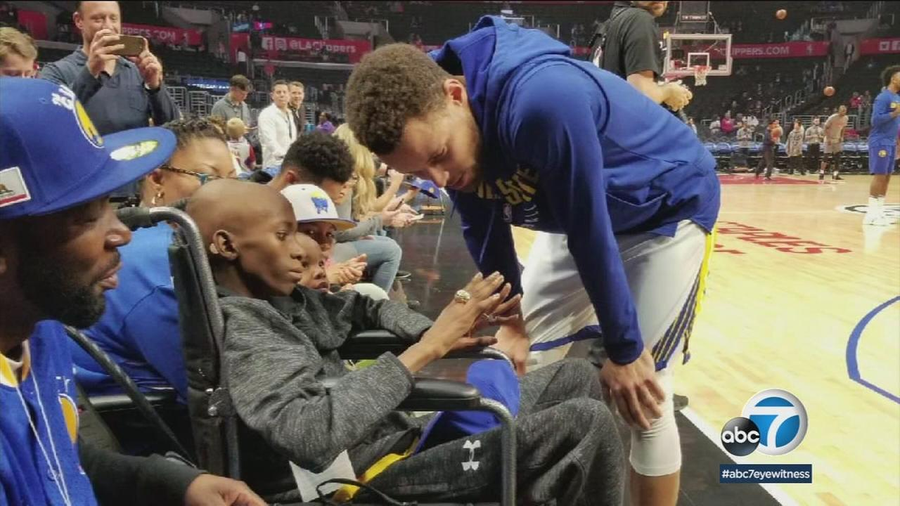 Cancer patient Jaylen Winzer, 13, tries on one of Stephen Currys NBA championship rings before the Warriors took on the Clippers on Saturday, Jan. 6, 2018, at Staples Center.