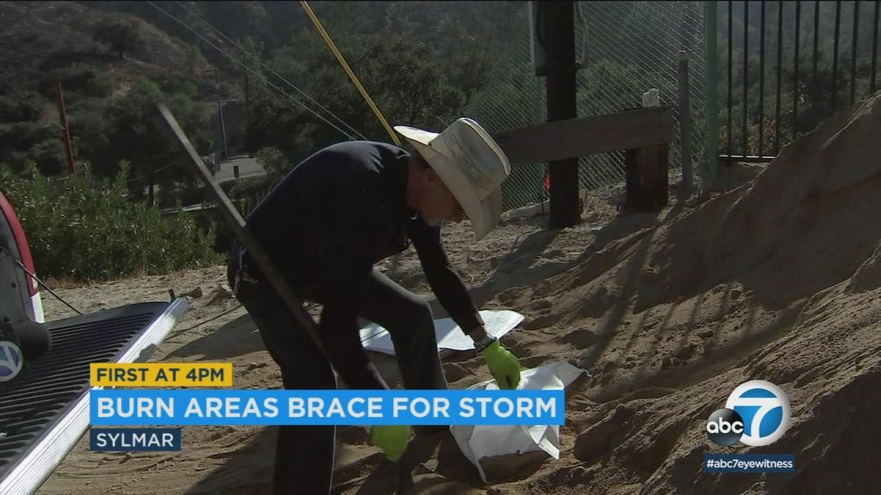 Archie Powell is preparing his Sylmar home for a pending rainstorm.